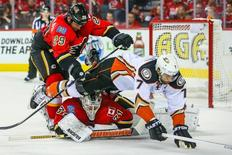 May 8, 2015; Calgary, Alberta, CAN; Calgary Flames goalie Karri Ramo (31) makes a save as Anaheim Ducks center Andrew Cogliano (7) and Calgary Flames defenseman Deryk Engelland (29) battle for the puck during the second period in game four of the second round of the 2015 Stanley Cup Playoffs at Scotiabank Saddledome. Mandatory Credit: Sergei Belski-USA TODAY Sports