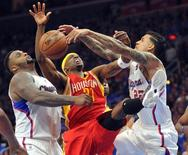 May 8, 2015; Los Angeles, CA, USA; Houston Rockets guard Jason Terry (31) is defended by Los Angeles Clippers forward Glen Davis (0) and forward Matt Barnes (22) during the first half in game three of the second round of the NBA Playoffs. at Staples Center. Mandatory Credit: Gary A. Vasquez-USA TODAY Sports