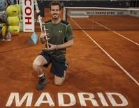 Britain's Andy Murray poses with his trophy after winning the final match over Spain's Rafael Nadal at the Madrid Open tennis tournament in Madrid, Spain, May 10, 2015. REUTERS/Sergio Perez