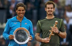 Britain's Andy Murray (R) and Spain's Rafael Nadal hold their trophies after their final match at the Madrid Open tennis tournament in Madrid, Spain, May 10, 2015. REUTERS/Sergio Perez