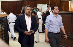 Al-Jazeera television journalists Mohamed Fahmy (L) and Baher Mohamed are seen at a court in Cairo after their retrial,  April 22, 2015. REUTERS/Shadi Bushra
