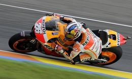 Honda MotoGP rider Dani Pedrosa of Spain races during the third free practice session ahead of the Valencia Motorcycle Grand Prix at the Ricardo Tormo racetrack in Cheste, near Valencia, November 8, 2014. REUTERS/Heino Kalis