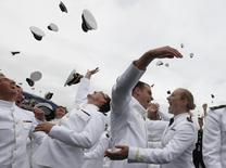 File photo of graduates celebrate graduating from the U.S. Naval Academy during commencement in Annapolis May 24, 2013.  REUTERS/Larry Downing