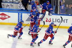 The New York Rangers celebrate after defeating the Washington Capitals during the overtime period of game seven of the second round of the 2015 Stanley Cup Playoffs at Madison Square Garden. The Rangers defeated the Capitals 2-1 in overtime. Mandatory Credit: Brad Penner-USA TODAY Sports