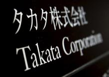 Takata Corp's company plate is seen at an entrance of the building where the Takata Corp headquarters is located in Tokyo in this December 9, 2014 file photo. REUTERS/Yuya Shino/Files