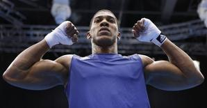Britain's Anthony Joshua celebrates after he was declared the winner over Italy's Roberto Cammarelle following their Men's Super Heavy (+91kg) gold medal boxing match at the London Olympics August 12, 2012.    REUTERS/Murad Sezer