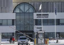 Employees leave work at a Bombardier plant in Montreal, in a file photo. REUTERS/Christinne Muschi