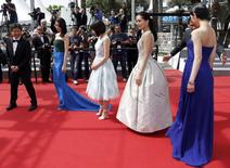 "(L-R) Director Hirokazu Koreeda, cast members Masami Nagasawa, Suzu Hirose, Haruka Ayase and Kaho pose on the red carpet as they arrive for the screening of the film ""Our Little Sister"" (aka Umimachi Diary) in competition at the 68th Cannes Film Festival in Cannes, southern France, May 14, 2015.           REUTERS/Regis Duvignau"