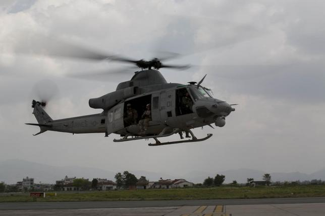 A UH-1Y Huey helicopter flies into the Tribhuvan International Airport after a search and rescue operation in Kathmandu, Nepal, May 13, 2015. REUTERS/Thor J. Larson/U.S. Marine Corps/Handout