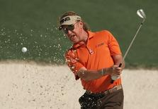 Miguel Angel Jimenez of Spain hits from the sand onto the tenth green during his practice round ahead of the 2015 Masters at the Augusta National Golf Course in Augusta, Georgia April 6, 2015.  REUTERS/Brian Snyder