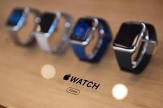 An Apple Watch logo is seen inside an Apple Store in Berlin April 10, 2015.  REUTERS/Stefanie Loos