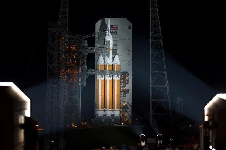 A United Launch Alliance Delta IV Heavy rocket with NASA's Orion spacecraft mounted atop is seen in this handout photo after the Mobile Service Tower was finished rolling back early on December 4, 2014, at Cape Canaveral Air Force Station's Space Launch Complex 37, Florida. REUTERS/Bill Ingalls/NASA/Handout via Reuters