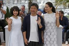 "Director Hirokazu Koreeda (C), cast members Suzu Hirose (L) and Haruka Ayase pose during a photocall for the film ""Our Little Sister"" (aka Umimachi Diary) at the 68th Cannes Film Festival in Cannes, southern France, May 14, 2015.      REUTERS/Benoit Tessier"