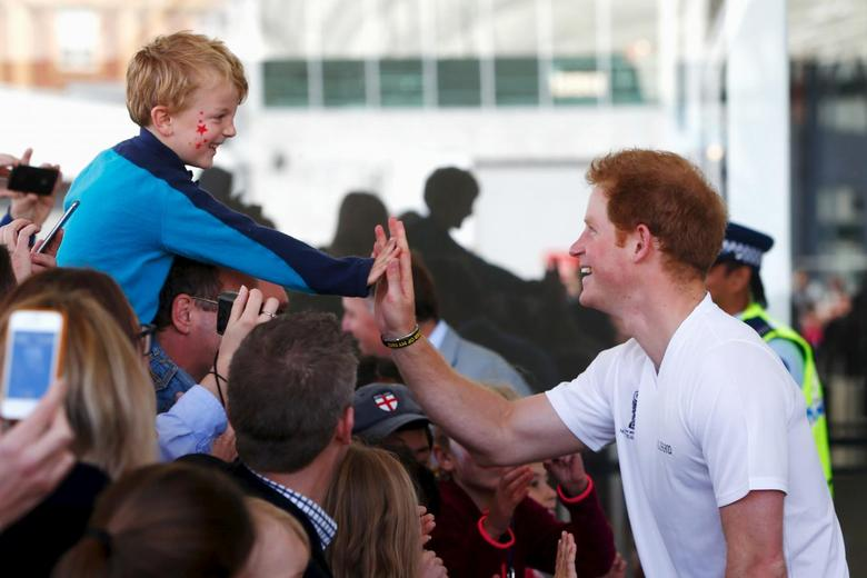 Britain's Prince Harry gives a high-five to a young fan at The Cloud during a walkabout in Auckland, New Zealand, May 16, 2015.   REUTERS/Phil Walter/Pool