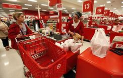 A Target employee checks out a customer at a store in Falls Church, Virginia May 14, 2012. REUTERS/Kevin Lamarque