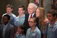 Warren Buffett poses for pictures with finalists at his Secret Millionaires Club 'Grow Your Own Business Challenge' in Omaha, Nebraska, United States, May 18, 2015.  REUTERS/Lane Hickenbottom