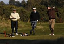 Competitors taking part in the World Hickory Golf Championships tee off during the first round at Monifeith Links golf course in Monifeith, east Scotland October 8, 2012. REUTERS/David Moir