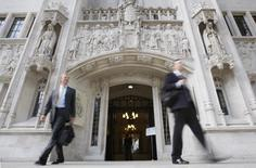 People walk out of the United Kingdom's new Supreme Court  in Westminster, central London September 14, 2009.  REUTERS/Andrew Winning