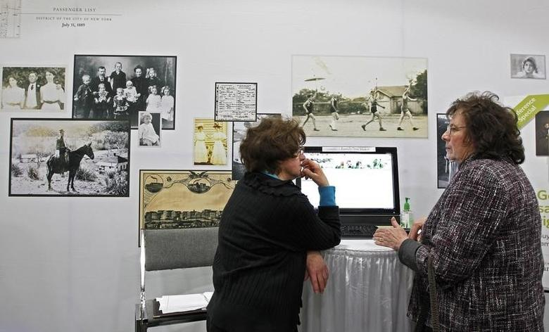 Two people talk at the Ancestry.com booth at the Rootstech Conference sponsored by Family Search in Salt Lake City, Utah February 7, 2014 REUTERS/George Frey