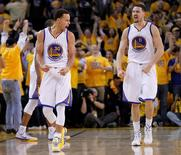 Golden State Warriors guard Stephen Curry (30) and guard Klay Thompson (11) celebrate the 99-98 victory against the Houston Rockets following the second half in game two of the Western Conference Finals of the NBA Playoffs. at Oracle Arena. Mandatory Credit: Cary Edmondson-USA TODAY Sports