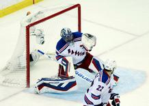 May 22, 2015; Tampa, FL, USA; New York Rangers goalie Henrik Lundqvist (30) makes a save against the Tampa Bay Lightning  in the third period in game four of the Eastern Conference Final of the 2015 Stanley Cup Playoffs at Amalie Arena. Kim Klement-USA TODAY Sports