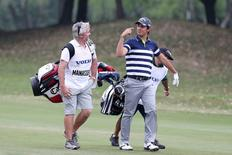 Italy's Matteo Manassero (R) talks with his caddy on the second day of the Volvo China Open at Tomson Golf Club in Pudong, Shanghai, China, April 24, 2015. REUTERS/Stringer