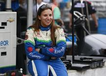 Simona de Silvestro of Switzerland sits on the pit lane wall smiling during a practice session prior to qualifications at the Indianapolis Motor Speedway in Indianapolis, Indiana in this file photo taken on May 18, 2013. REUTERS/Brent Smith