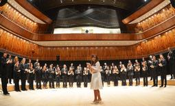 Argentina's President Cristina Fernandez de Kirchner applauds as she stands in front of musicians from Argentina's National Symphony Orchestra in the 'Blue Whale' auditorium during the official inauguration of the Kirchner Cultural Center in Buenos Aires, Argentina, May 21, 2015. REUTERS/Argentine Presidency/Handout via Reuters