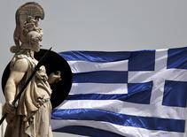 A Greek national flag flutters next to a statue of ancient Greek goddess Athena, in Athens May 21, 2015. REUTERS/Alkis Konstantinidis