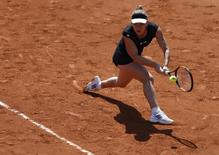Simona Halep of Romania plays a shot to Evgeniya Rodina of Russia during their women's singles match at the French Open tennis tournament at the Roland Garros stadium in Paris, France, May 24, 2015.       REUTERS/Vincent Kessler