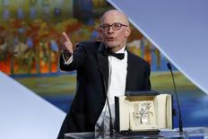 "Director Jacques Audiard, Palme d'Or award winner for his film ""Dheepan"", delivers a speech on stage during the closing ceremony of the 68th Cannes Film Festival in Cannes, southern France, May 24, 2015.                    REUTERS/Eric Gaillard"