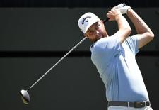 Chris Kirk hits his tee shot on the 1st hole during the final round of The Players Championship at TPC Sawgrass - Stadium Course. Mandatory Credit: John David Mercer-USA TODAY Sports