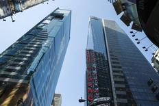 The Ernst & Young building rises above Times Square in New York June 18, 2014.  REUTERS/Lucas Jackson