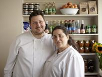 "Itamar Srulovich and Sarit Packer (R), authors of ""Honey & Co.: The Cookbook."" Spring 2013 are shown in this undated London, England handout photo.  REUTERS/Patricia Niven/Handout via Reuters"