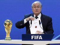 FIFA President Sepp Blatter announces Russia as the host nation for the FIFA World Cup 2018, in Zurich in this December 2, 2010 file picture. REUTERS/Christian Hartmann/Files