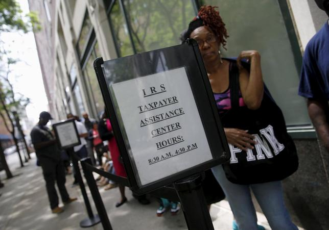 People wait outside the Internal Revenue Service office in the Brooklyn borough of New York May 27, 2015. REUTERS/Shannon Stapleton