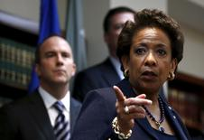 U.S. Attorney General Loretta Lynch points during a news conference at the U.S. Attorney's Office of the Eastern District of New York in the Brooklyn borough of New York May 27, 2015. U.S. authorities said nine soccer officials and five sports media and promotions executives faced corruption charges involving more than $150 million in bribes. In pursuit of the U.S. case, Swiss police arrested seven FIFA officials who are now awaiting extradition to the United States. REUTERS/Shannon Stapleton