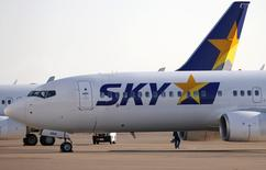 Skymark Airlines a soumis vendredi son plan de restructuration à la justice japonaise en dépit de l'opposition de ses créanciers Airbus Group et Intrepid Aviation. Le plan prévoit que les principaux bailleurs de fonds de la compagnie aérienne renoncent à 95% de leurs créances. /Photo d'archives/REUTERS/Toru Hanai