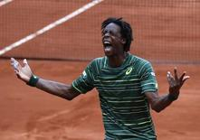 Gael Monfils of France celebrates after beating Pablo Cuevas of Uruguay during their men's singles match at the French Open tennis tournament at the Roland Garros stadium in Paris, France, May 29, 2015.  REUTERS/Pascal Rossignol