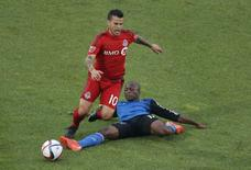 May 30, 2015; Toronto, Ontario, CAN; Toronto FC forward Sebastian Giovinco (10) is tripped as he runs with the ball by San Jose Earthquakes midfielder Sanna Nyassi (17) at BMO Field. Tom Szczerbowski-USA TODAY Sports