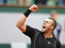 Jo-Wilfried Tsonga of France celebrates after beating Tomas Berdych of the Czech Republic during their men's singles match at the French Open tennis tournament at the Roland Garros stadium in Paris, France, May 31, 2015. REUTERS/Pascal Rossignol