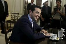 Greek Prime Minister Alexis Tsipras smiles during a meeting with Iranian Foreign Minister Mohammad Javad Zarif (not pictured) in Athens May 28, 2015.  REUTERS/Alkis Konstantinidis