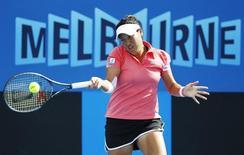 Tamarine Tanasugarn of Thailand hits a return to Ekaterina Makarova of Russia during their women's singles match at the Australian Open tennis tournament in Melbourne January 17, 2012.  REUTERS/Vivek Prakash