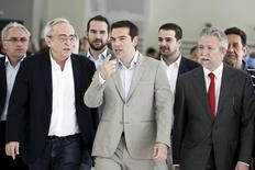 Greek Prime Minister Alexis Tsipras (C) gestures as he is escorted by Minister for Culture, Education and Religious Affairs Aristides Baltas (2nd L), Deputy Minister for Culture, Education and Religious Affairs Stavros Kontonis (R) and government spokesman Gabriel Sakellaridis (rear, 2nd R) during his visit at the ministry in Athens June 2, 2015.  REUTERS/Alkis Konstantinidis