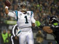 Carolina Panthers quarterback Cam Newton (1) throws under pressure against the defense of Seattle Seahawks outside linebacker K.J. Wright (50) during the first half in the 2014 NFC Divisional playoff football game at CenturyLink Field. January 10, 2015; Seattle, WA, USA; Kirby Lee-USA TODAY Sports