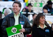 Jim Bob Duggar (L) and his wife Michelle Duggar (R) in Columbia, South Carolina, on the steps of the State House in this file photo from January 14, 2012.  REUTERS/Chris Keane/Files
