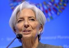 Christine Lagarde, la directrice générale du FMI. Selon le Fonds monétaire international, la Réserve fédérale devrait repousser sa première hausse des taux au premier semestre 2016, lorsque se seront manifestés des signes plus évidents d'inflation par les prix ou les salaires. /Photo prise le16 avril 2015/REUTERS/Mike Theiler
