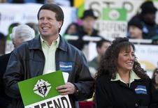 Jim Bob Duggar (L) and his wife Michelle Duggar (R) in Columbia, South Carolina, on the steps of the State House January 14, 2012. REUTERS/Chris Keane