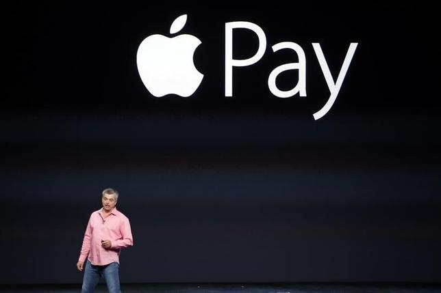 Eddy Cue, Apple's senior vice president of Internet Software and Service, introduces Apple Pay during an Apple event at the Flint Center in Cupertino, California, September 9, 2014. REUTERS/Stephen Lam