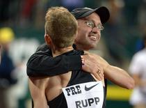 May 30, 2014; Eugene, OR, USA; Galen Rupp (USA) embraces coach Alberto Salazar after winning the 10,000m in an American record 26:44.39 in the 40th Prefontaine Classic at Hayward Field. Mandatory Credit: Kirby Lee-USA TODAY Sports